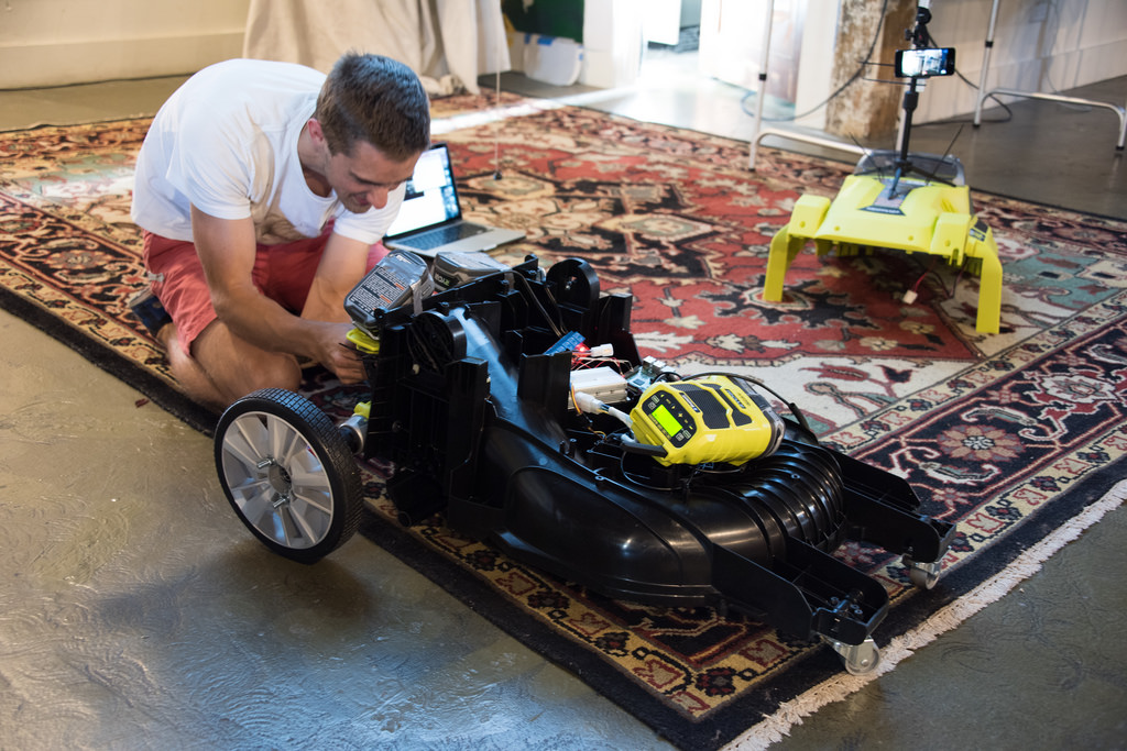 Mower with the top cover off and Dan working